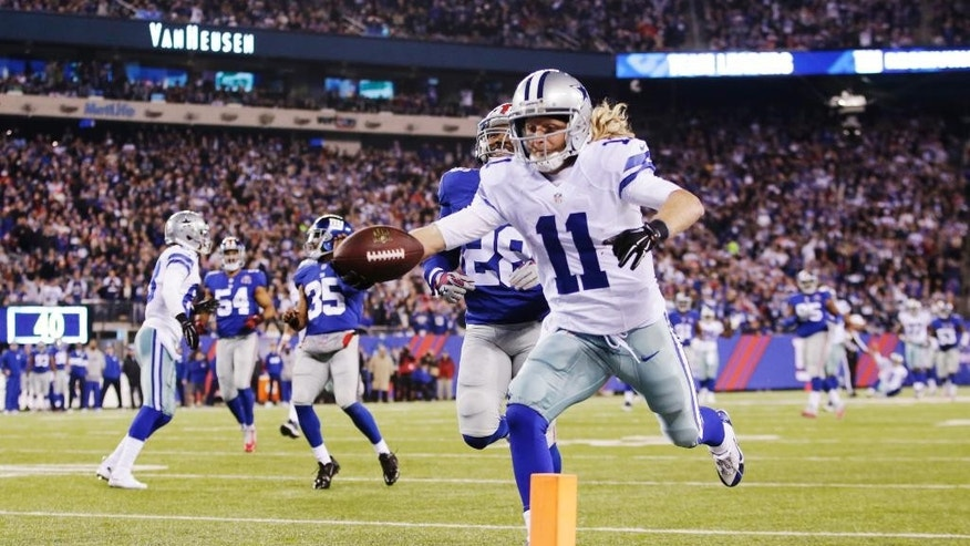 Dallas Cowboys wide receiver Cole Beasley (11) reaches for the goal line as he runs the ball for a touchdown against the New York Giants in the third quarter of an NFL football game, Sunday, Nov. 23, 2014, in East Rutherford, N.J. (AP Photo/Kathy Willens)