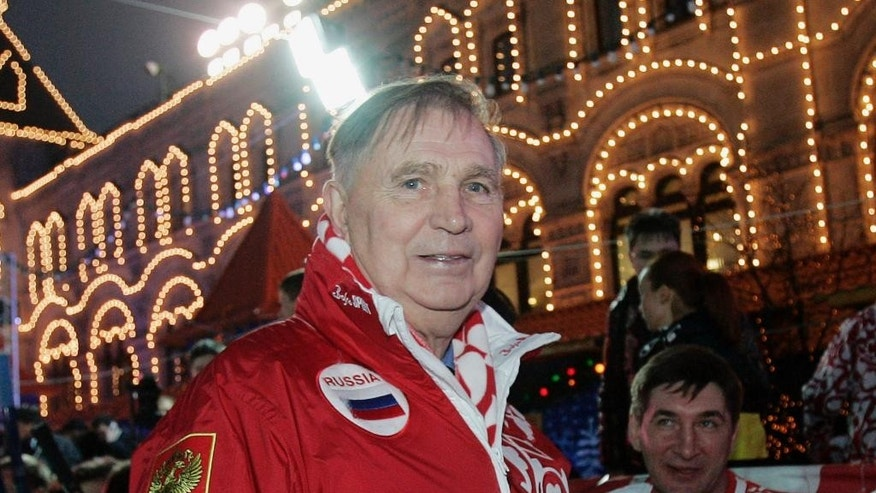 "FILE - In this Saturday, Dec. 9, 2006 file photo, Legendary Soviet ice hockey coach Viktor Tikhonov, centre, stands at the ""Team USSR"" bench prior to the charity ice hockey match, at the Moscow's Red Square. The legendary Russian hockey coach Viktor Tikhonov, whose teams won three Olympic gold medals, has died after an undisclosed long illness. He was 84. Russia's Kontinental Hockey League said early Monday, Nov. 24, 2014,  that Tikhonov died overnight. He had been receiving treatment at home for an illness that had left him unable to walk in recent weeks. (AP Photo/Ivan Sekretarev, File)"