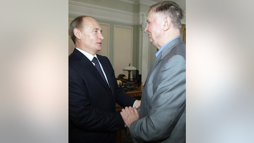 FILE - In this Friday, June 4, 2010 file photo, Russian Prime Minister Vladimir Putin, left, meets famous Soviet ice hockey coach of CSKA and the Russian national team Viktor Tikhonov, at Novo-Ogaryovo residence outside Moscow. The legendary Russian hockey coach Viktor Tikhonov, whose teams won three Olympic gold medals, has died after an undisclosed long illness. He was 84. Russia's Kontinental Hockey League said early Monday, Nov. 24, 2014,  that Tikhonov died overnight. He had been receiving treatment at home for an illness that had left him unable to walk in recent weeks. (AP Photo/ Alexei Nikolsky, Pool, File)
