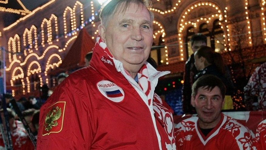 "Dec. 9, 2006: In this file photo, Legendary Soviet ice hockey coach Viktor Tikhonov, centre, stands at the ""Team USSR"" bench prior to the charity ice hockey match, at the Moscow's Red Square. (AP)"