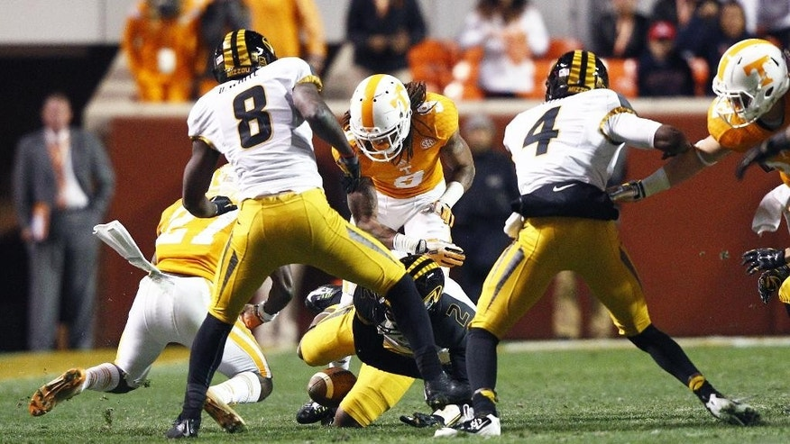 The ball is loose between the legs of Missouri wide receiver Nate Brown (2) on an onside kick as Tennessee defensive back Justin Coleman (27) recovers the ball in the second half of an NCAA college football game Saturday, Nov. 22, 2014 in Knoxville, Tenn. Missouri won 29-21. (AP Photo/Wade Payne)