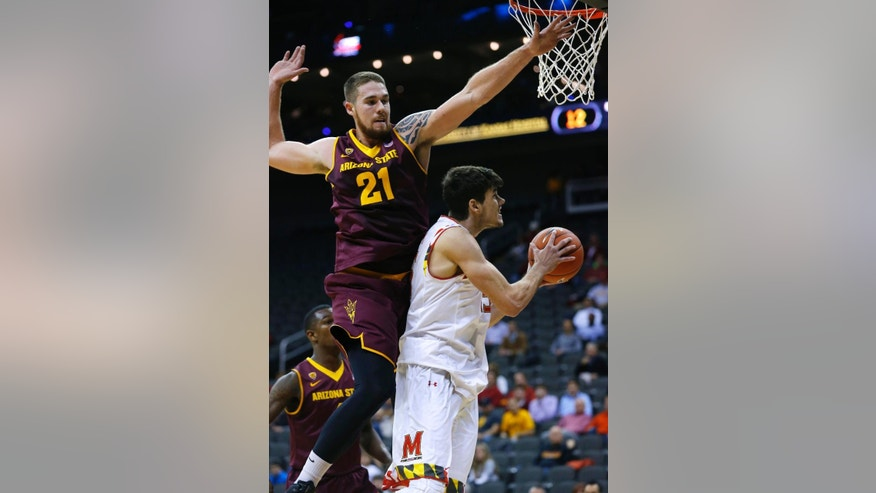 Maryland forward Michal Cekovsky, right, goes up for a shot against Arizona State's Eric Jacobsen (21) in the first half of the CBE Hall of Fame Classic college baseball game Monday, Nov. 24, 2014, in Kansas City, Mo. (AP Photo/Ed Zurga)