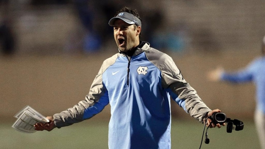 North Carolina coach Larry Fedora argues with an official during the second half of an NCAA college football game against Duke in Durham, N.C., Thursday, Nov. 20, 2014. North Carolina won 45-20. (AP Photo/Gerry Broome)