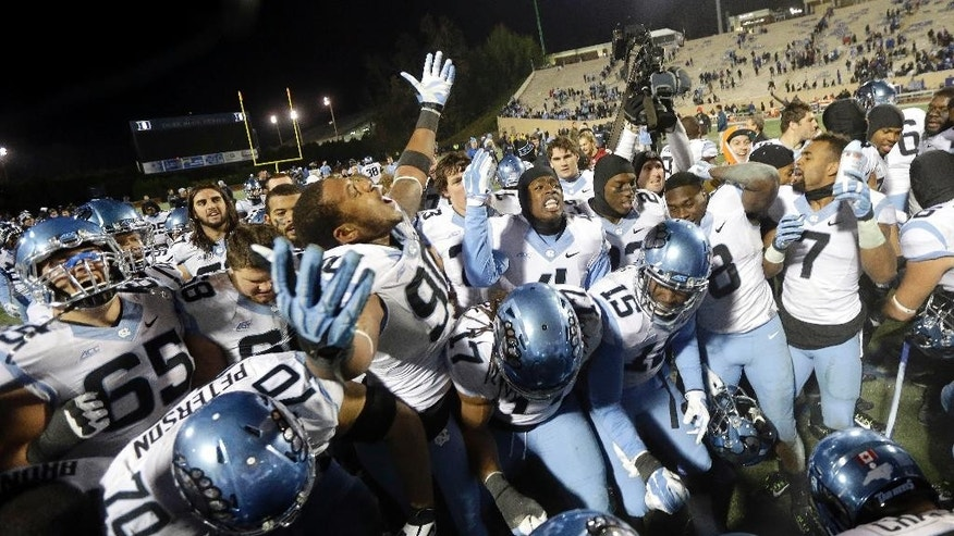 North Carolina players celebrate following a 45-20 win over Duke in an NCAA college football game in Durham, N.C., Thursday, Nov. 20, 2014. (AP Photo/Gerry Broome)