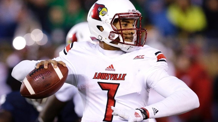 Louisville quarterback Reggie Bonnafon looks to a pass during the first half of an NCAA college football game against Notre Dame in South Bend, Ind., Saturday, Nov. 22, 2014. (AP Photo/Nam Y. Huh)