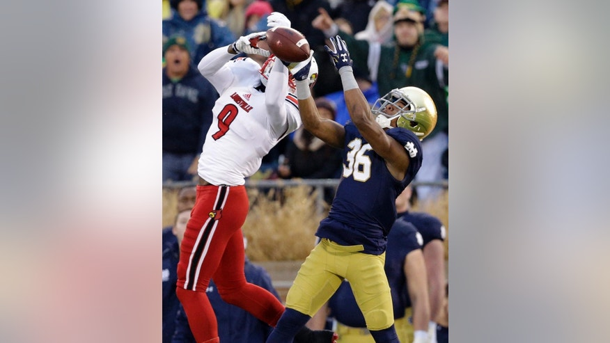 Louisville wide receiver DeVante Parker (9) can't make the catch against Notre Dame cornerback Cole Luke (36) during the first half of an NCAA college football game in South Bend, Ind., Saturday, Nov. 22, 2014. (AP Photo/Nam Y. Huh)