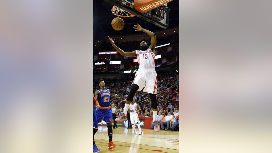 Houston Rockets' James Harden (13) dunks the ball against the New York Knicks during the third quarter of an NBA basketball game Monday, Nov. 24, 2014, in Houston. (AP Photo/David J. Phillip)