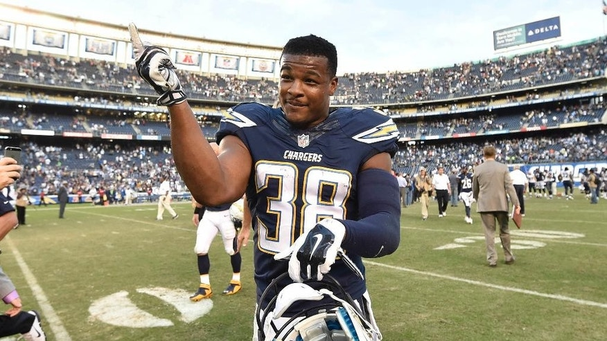 San Diego Chargers strong safety Marcus Gilchrist (38) celebrates on the field after the Chargers defeated the St. Louis Rams 27-24 in an NFL football game, Sunday, Nov. 23, 2014, in San Diego. (AP Photo/Denis Poroy)