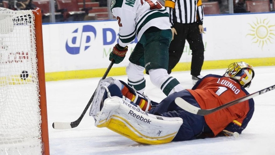 Minnesota Wild right wing Nino Niederreiter (22) watches after scoring a goal against Florida Panthers goalie Roberto Luongo (1) during the first period of an NHL hockey game, Monday, Nov. 24, 2014, in Sunrise, Fla.(AP Photo/Lynne Sladky)