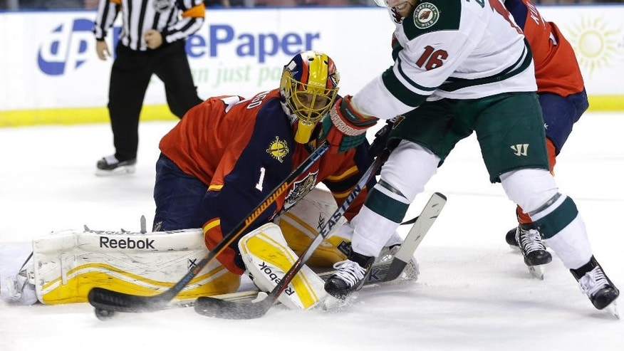 Minnesota Wild left wing Jason Zucker (16) attempts a shot on the goal as Florida Panthers goalie Roberto Luongo (1) defends during the first period of an NHL hockey game, Monday, Nov. 24, 2014, in Sunrise, Fla.(AP Photo/Lynne Sladky)