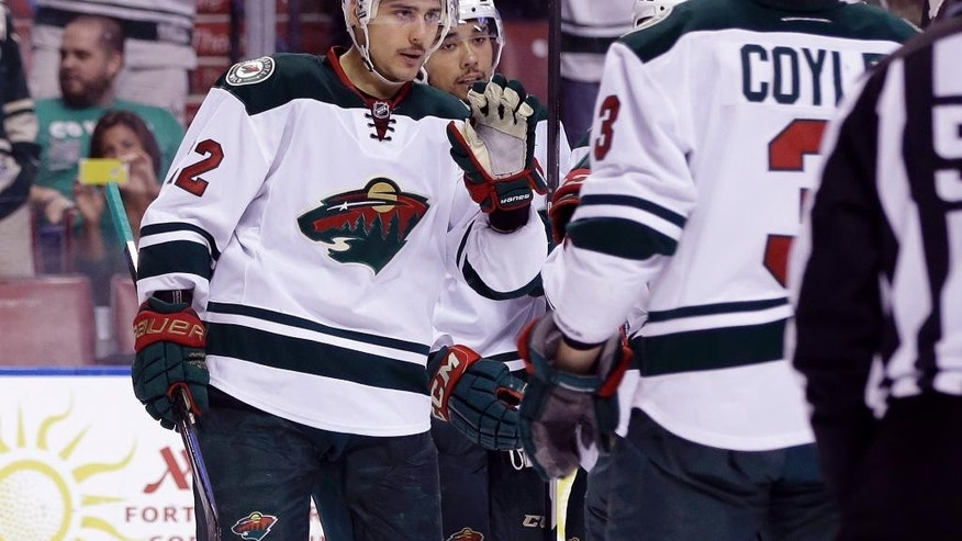 Minnesota Wild right wing Nino Niederreiter (22) reacts after scoring a goal during the first period of an NHL hockey game against the Florida Panthers, Monday, Nov. 24, 2014, in Sunrise, Fla.(AP Photo/Lynne Sladky)