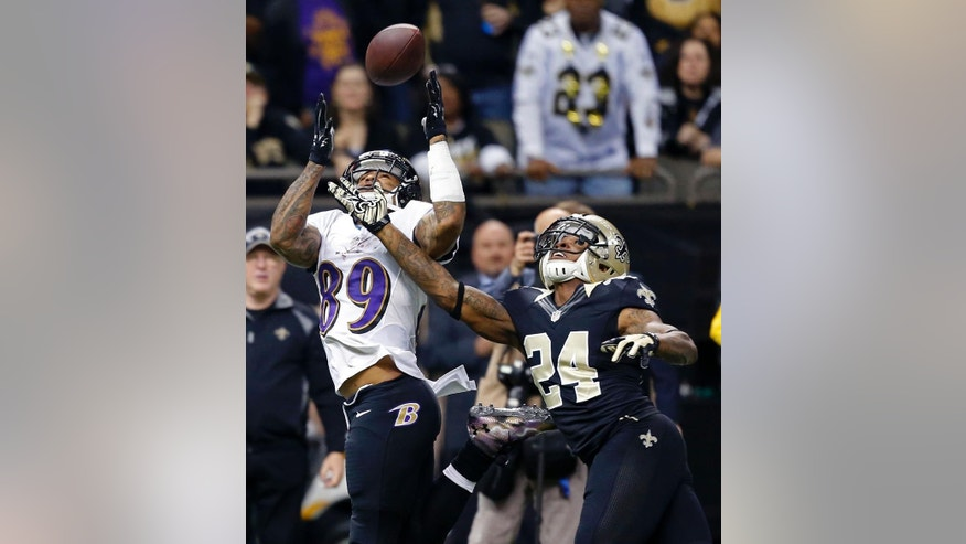 Baltimore Ravens wide receiver Steve Smith (89) pulls in a pass reception in front of New Orleans Saints cornerback Corey White (24) in the first half of an NFL football game in New Orleans, Monday, Nov. 24, 2014. (AP Photo/Rogelio Solis)