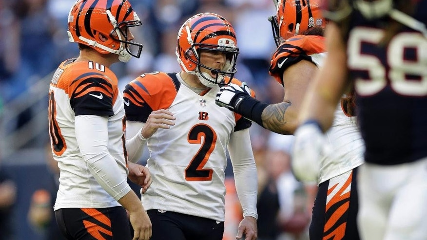 Cincinnati Bengals' Mike Nugent (2) celebrates with teammates after he kicked a field goal against the Houston Texans during the fourth quarter of an NFL football game, Sunday, Nov. 23, 2014, in Houston. (AP Photo/Patric Schneider)