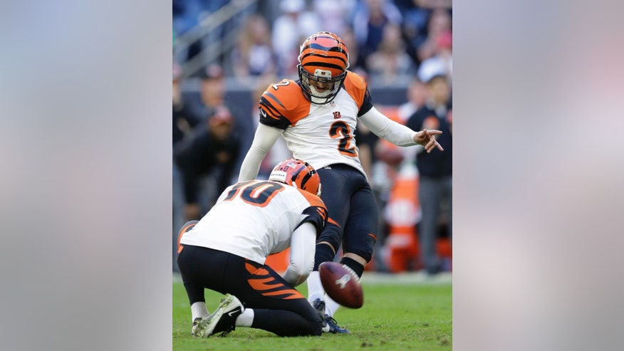Cincinnati Bengals' Mike Nugent (2) kicks a field goal against the Houston Texans as Kevin Huber (10) holds during the fourth quarter of an NFL football game, Sunday, Nov. 23, 2014, in Houston. (AP Photo/Patric Schneider)