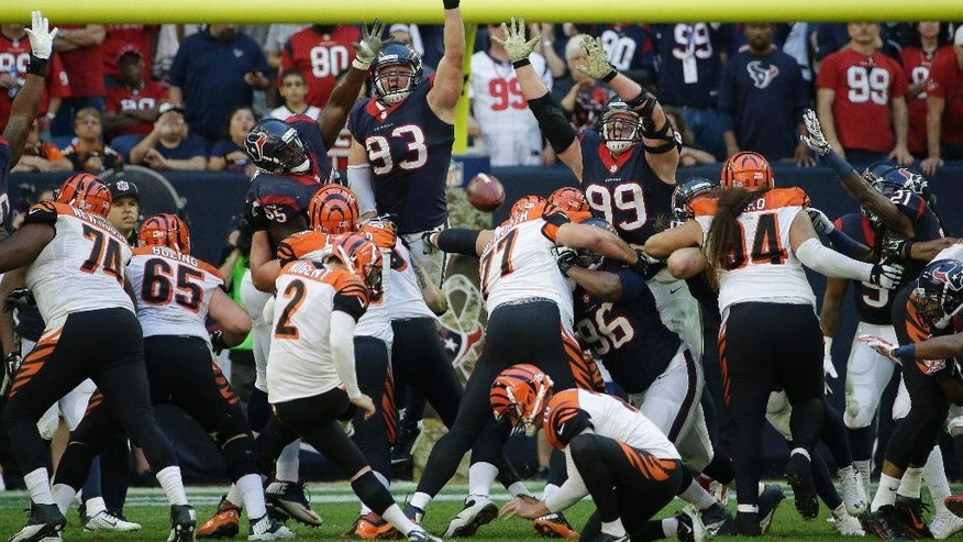 Cincinnati Bengals' Mike Nugent (2) kicks a field goal against the Houston Texans during the fourth quarter of an NFL football game, Sunday, Nov. 23, 2014, in Houston. (AP Photo/David J. Phillip)