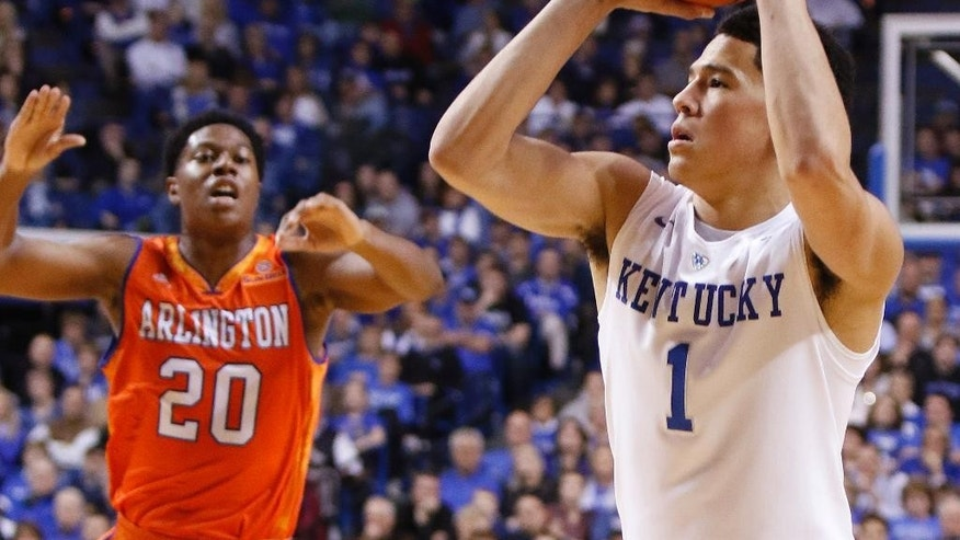 Kentucky's Devin Booker (1) shoots a three point shot near Texas-Arlington's Julien Harris (20) during the second half of an NCAA college basketball game, Tuesday, Nov. 25, 2014, in Lexington, Ky. Kentucky won 92-44. (AP Photo/James Crisp)