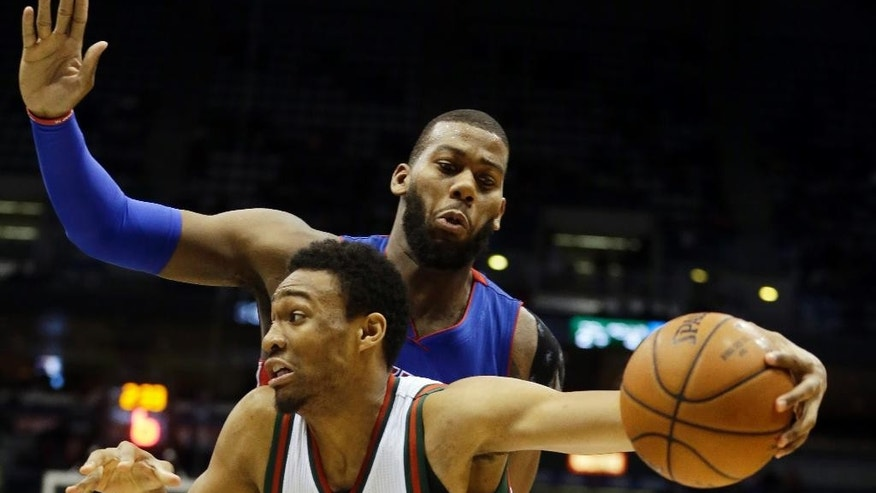 Milwaukee Bucks' Jabari Parker drives past Detroit Pistons' Greg Monroe, back, during the second half of an NBA basketball game Tuesday, Nov. 25, 2014, in Milwaukee. The Bucks won 98-86. (AP Photo/Morry Gash)