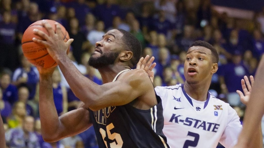 Purdue guard Rapheal Davis (35) drives past Kansas State guard Marcus Foster (2) for a shot in the second half of an NCAA college basketball game at the Maui Invitational on Monday, Nov. 24, 2014, in Lahaina, Hawaii. Kansas State beat Purdue 88-79. (AP Photo/Eugene Tanner)