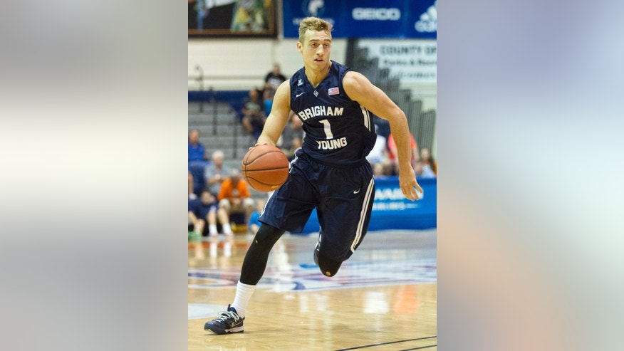 BYU guard Chase Fischer  dribbles while playing against Chaminade in the first half of an NCAA college basketball game at the Maui Invitational on Tuesday, Nov. 25, 2014, in Lahaina, Hawaii. (AP Photo/Eugene Tanner)