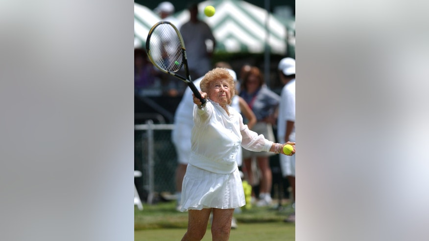 "FILE - In this July 10, 2004, file photo, Tennis great Dorothy ""Dodo"" Cheney, 87, of Santa Monica, Calif., plays during an exhibition match prior to ceremonies celebrating the 50th anniversary of the Tennis Hall of Fame in Newport, R.I. The International Tennis Hall of Fame says Cheney, a member of the Hall and the first American woman to win the tournament now known as the Australian Open, has died at age 98. The Hall says Tuesday, Nov. 25, 2014, that Cheney died Sunday in Escondido, Calif., following a brief illness. (AP Photo/Victoria Arocho, File)"