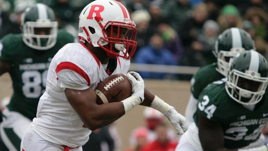 Rutgers' Robert Martin, left, rushes against Michigan State's Taiwan Jones (34) during the first quarter of an NCAA college football game, Saturday, Nov. 22, 2014, in East Lansing, Mich. Michigan State won 45-3. (AP Photo/Al Goldis)