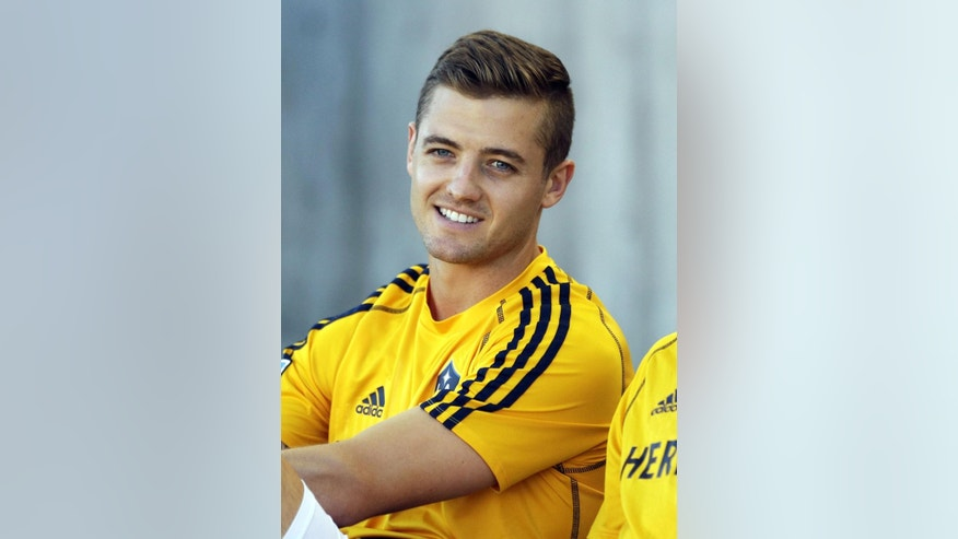 "This June 8, 2013 file photo shows LA Galaxy's Robbie Rogers before the first half during an MLS soccer game against Real Salt Lake in Sandy, Utah. Rogers, the first openly gay male athlete to play in a U.S. professional league, has a memoir coming out. Rogers chronicles his struggles with faith and family acceptance in the memoir ""Coming Out To Play,"" released Tuesday, Nov. 25, 2014, by Penguin Books.  (AP Photo/Rick Bowmer, File)"