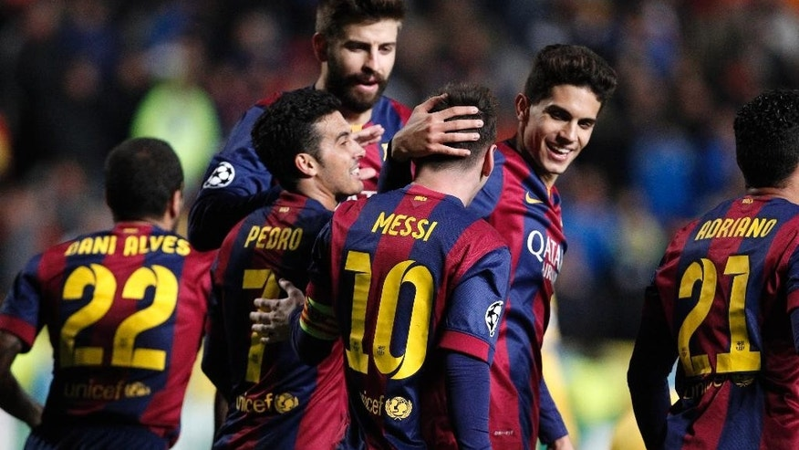 Barcelona's Lionel Messi celebrates with teammates scoring his side's 4th goal during a Champions League Group F soccer match between APOEL and FC Barcelona at GSP stadium, in Nicosia, Cyprus, Tuesday, Nov. 25, 2014. (AP Photo/Petros Karadjias)