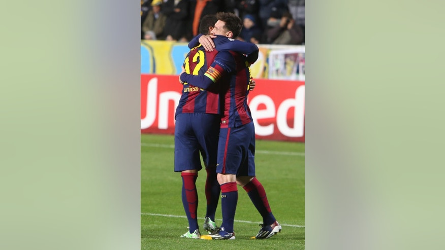 Barcelona's Lionel Messi is congratulate by his teammate Rafinha after scoring against APOEL during the Champions League Group F soccer match between Apoel and Barcelona, at GSP stadium in Nicosia, Cyprus, Tuesday, Nov. 25, 2014. (AP Photo/ Philippos Christou)