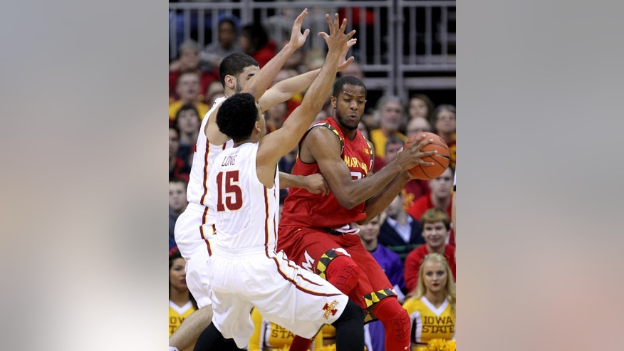 Maryland forward Damonte Dodd, right, tries to make a move to the basket against Iowa State guard Naz Long (15) and Georges Niang, back left, in the first half of an NCAA college basketball tournament Tuesday, Nov. 25, 2014, in Kansas City, Mo. (AP Photo/Ed Zurga)