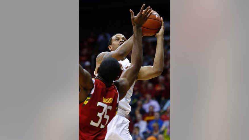 Iowa State guard Bryce Dejean-Jones, back, shoots past Maryland forward Damonte Dodd (35) in the first half of an NCAA college basketball tournament Tuesday, Nov. 25, 2014, in Kansas City, Mo. (AP Photo/Ed Zurga)
