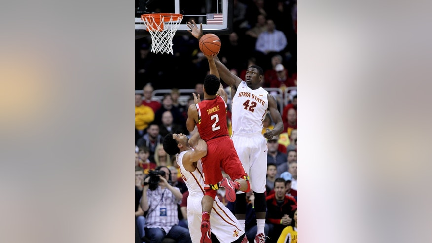 Maryland guard Melo Trimble (2) takes a shot between Iowa State guard Naz Long (15) and Daniel Edozie (42) in the first half of an NCAA college basketball tournament Tuesday, Nov. 25, 2014, in Kansas City, Mo. (AP Photo/Ed Zurga)