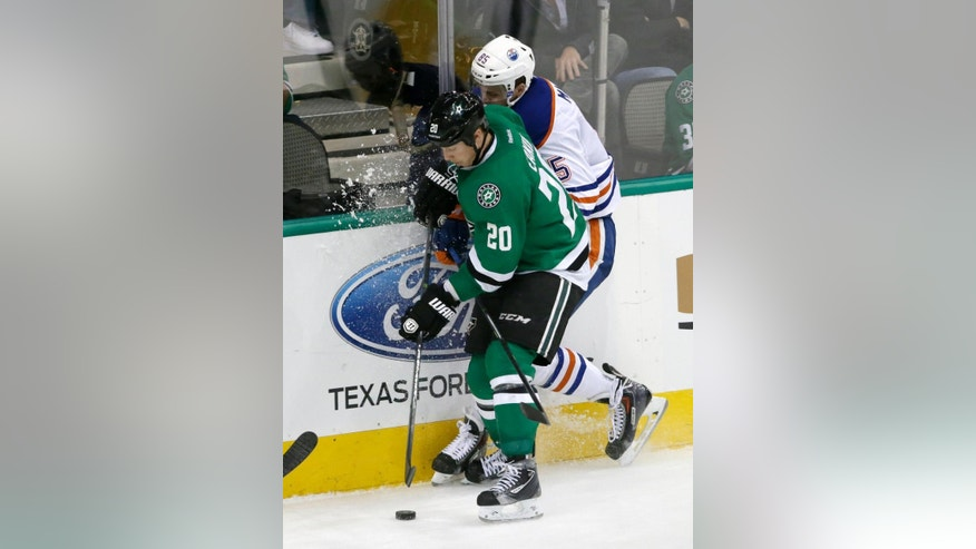 Dallas Stars center Cody Eakin (20) checks Edmonton Oilers' Martin Marincin (85) of Slovakia against the boards to gain control of a loose puck in the third period of an NHL hockey game, Tuesday, Nov. 25, 2014, in Dallas. The Stars won 3-2. (AP Photo/Tony Gutierrez)