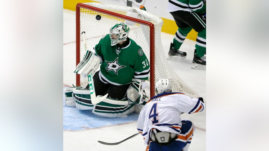 Dallas Stars goalie Kari Lehtonen (32) of Finland looks over his shoulder at a goal scored by Edmonton Oilers' Taylor Hall (4) in the third period of an NHL hockey game, Tuesday, Nov. 25, 2014, in Dallas. The Stars won 3-2. (AP Photo/Tony Gutierrez)
