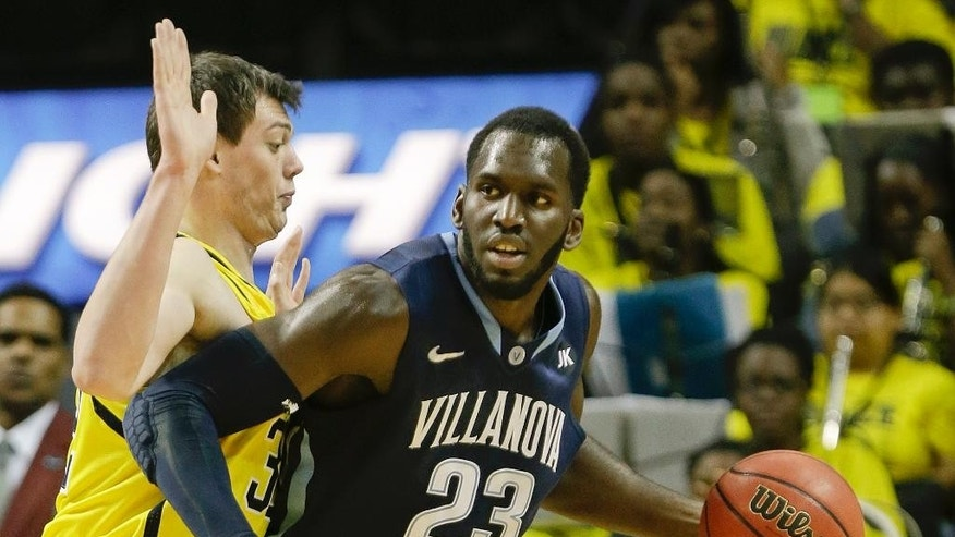 Michigan's Ricky Doyle, left, defends Villanova's Daniel Ochefu (23) during the first half of an NCAA college basketball game Tuesday, Nov. 25, 2014, in New York. (AP Photo/Frank Franklin II)