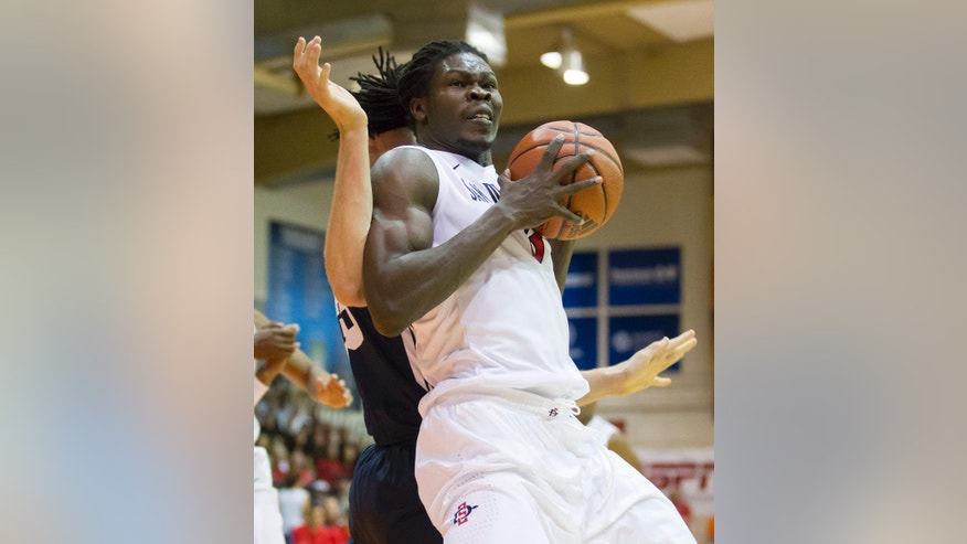 San Diego State forward Angelo Chol (3) post up on Brigham Young forward Isaac Neilson, back in the first half of an NCAA college basketball game at the Maui Invitational on Monday, Nov. 24, 2014, in Lahaina, Hawaii. (AP Photo/Eugene Tanner)