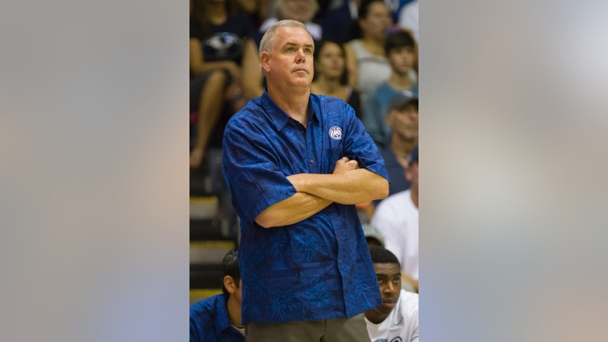 Brigham Young head coach Dave Rose watches his team play San Diego State in the first half of an NCAA college basketball game at the Maui Invitational on Monday, Nov. 24, 2014, in Lahaina, Hawaii. (AP Photo/Eugene Tanner)