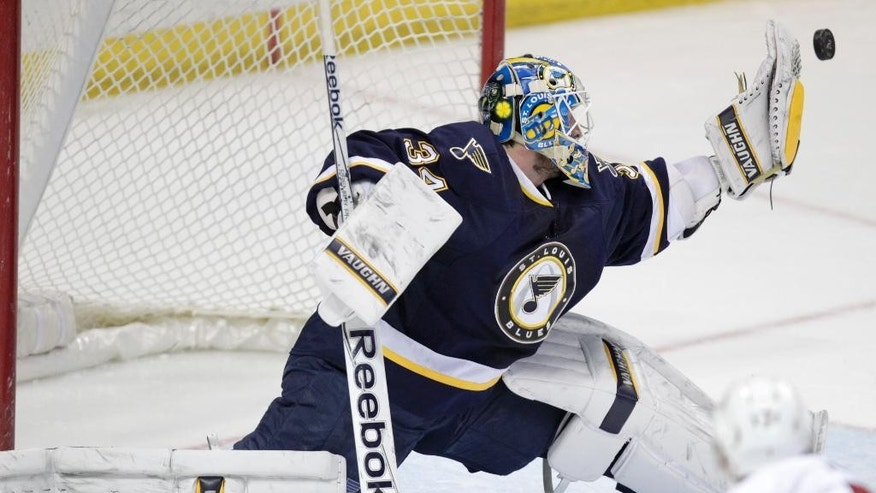 St. Louis Blues goalie Jake Allen (34) makes a glove save in the overtime period of a NHL hockey game against the Ottawa Senators, Tuesday, Nov. 25, 2014 in St. Louis. The Senators beat the Blues 3-2 in a shootout, (AP Photo/Tom Gannam)