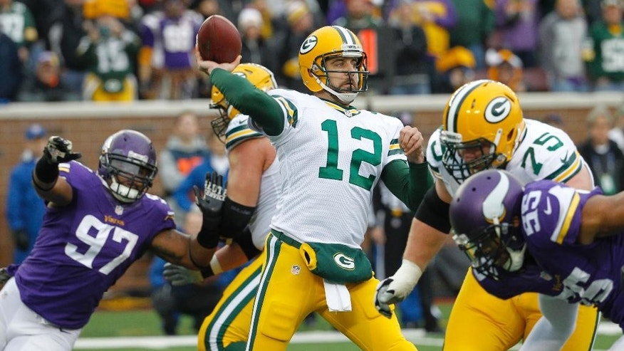 Green Bay Packers quarterback Aaron Rodgers (12) throws a pass during the second half of an NFL football game against the Minnesota Vikings, Sunday, Nov. 23, 2014, in Minneapolis. (AP Photo/Ann Heisenfelt)