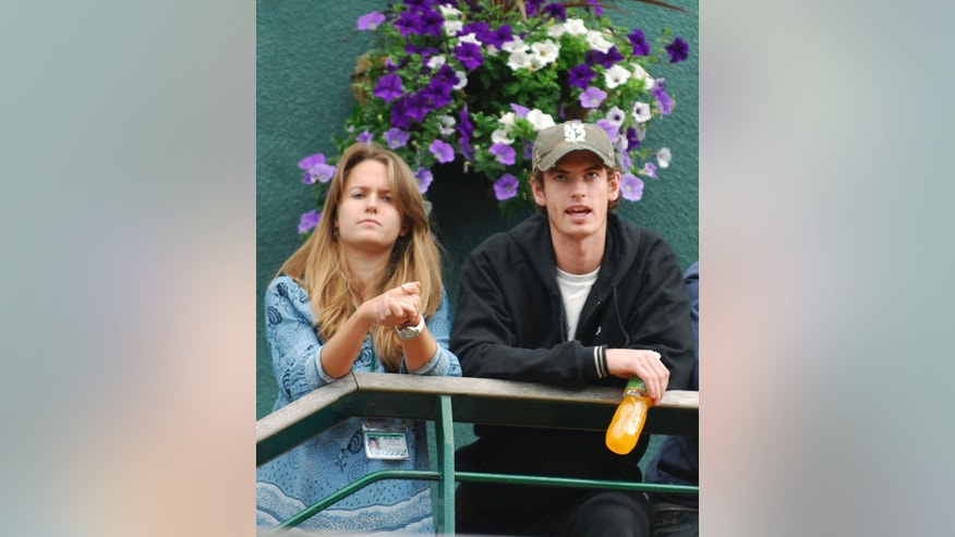FILE - In this file photo dated Friday June 29, 2007, Britain's Andy Murray stands with his girlfriend Kim Sears, as they look out from a balcony at Wimbledon, in London.  Murray has got engaged to his long-term girlfriend Kim Sears, his agent has confirmed Wednesday Nov. 26, 2014. (AP Photo/Odd Andersen)  EDITORIAL USE ONLY