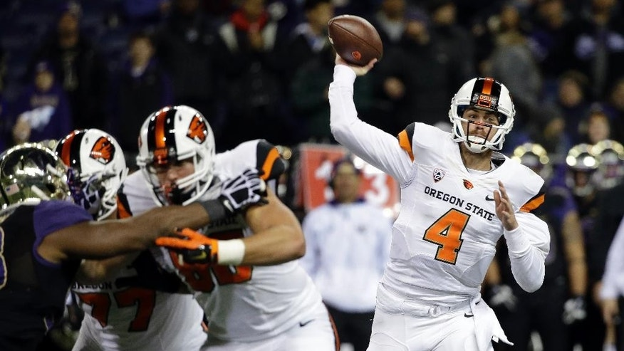 Oregon State quarterback Sean Mannion passes against Washington in the first half of an NCAA college football game Saturday, Nov. 22, 2014, in Seattle. (AP Photo/Elaine Thompson)