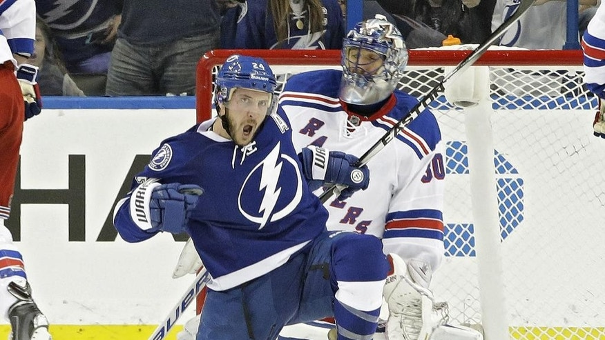 Tampa Bay Lightning right wing Ryan Callahan (24) celebrates after scoring past New York Rangers goalie Henrik Lundqvist (30), of Sweden, during the first period of an NHL hockey game Wednesday, Nov. 26, 2014, in Tampa, Fla. (AP Photo/Chris O'Meara)