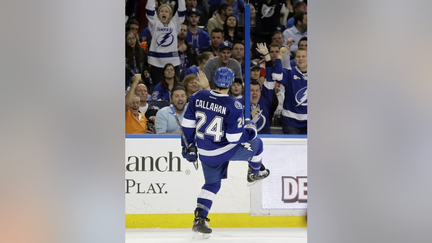 Tampa Bay Lightning right wing Ryan Callahan celebrates in front of the fans after scoring against the New York Rangers during the second period of an NHL hockey game Wednesday, Nov. 26, 2014, in Tampa, Fla. (AP Photo/Chris O'Meara)