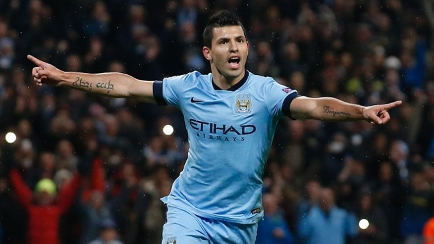 Manchester City's Sergio Aguero celebrates after scoring a penalty on Tuesday, Nov. 25, 2014.