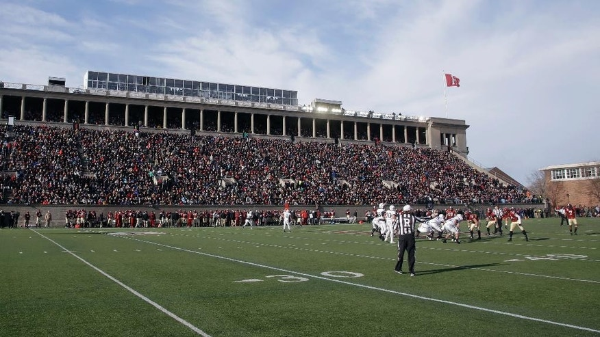 In this Nov. 22, 2014 photo, Harvard and Yale football teams compete in Harvard Stadium in Cambridge, Mass. Boston is bidding on the 2024 Summer Olympics, and Harvard Stadium could be used as a venue for field hockey. The crux of the proposal is a walkable, sustainable, technology-based event that would harness the resources of the area's 100 colleges and universities to keep the Games affordable and compact. (AP Photo/Stephan Savoia)