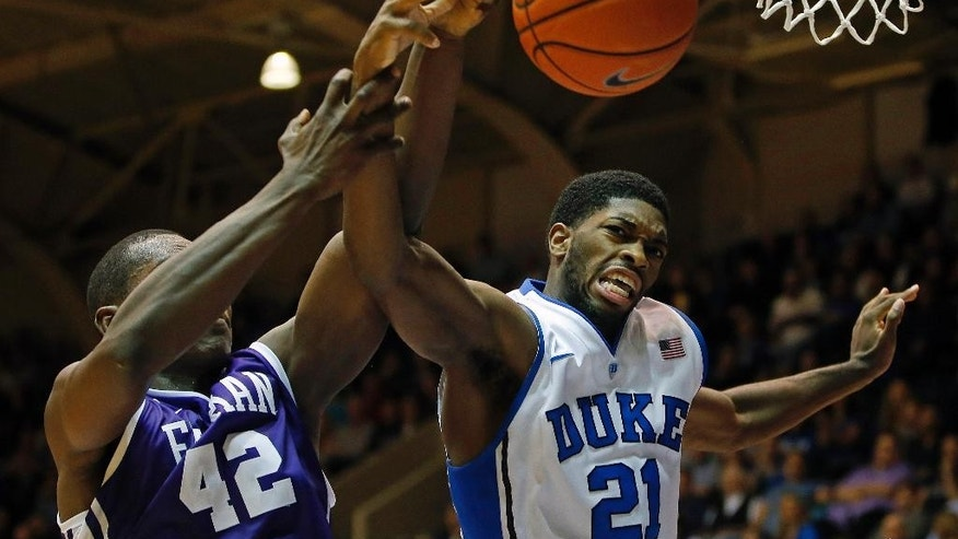 Duke's Amile Jefferson (21) battles with Furman's Kevin Chuisseu (42) during the first half of an NCAA college basketball game in Durham, N.C., Wednesday, Nov. 26, 2014. (AP Photo/Karl B DeBlaker)