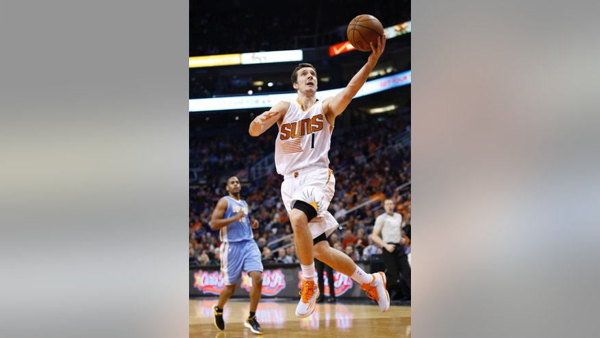 Phoenix Suns' Goran Dragic (1) gets past Denver Nuggets' Arron Afflalo, left, to score during the second half of an NBA basketball game Wednesday, Nov. 26, 2014, in Phoenix.  The Suns defeated the Nuggets 120-112. (AP Photo/Ross D. Franklin)