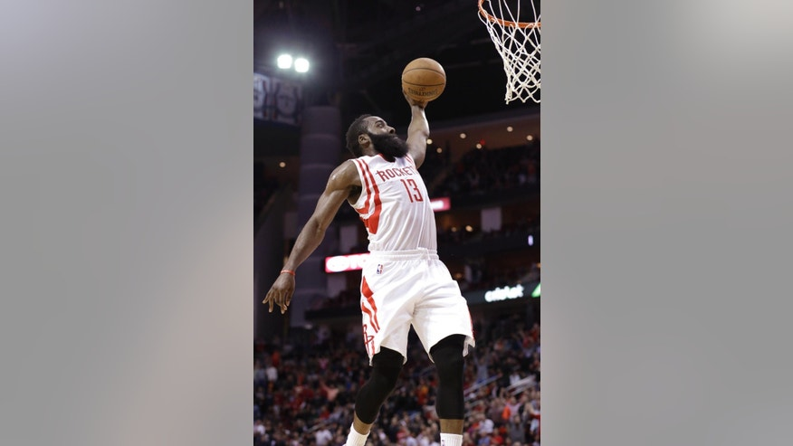 Houston Rockets' James Harden goes up to dunk the ball against the Sacramento Kings in the second half of an NBA basketball game Wednesday, Nov. 26, 2014, in Houston. The Rockets won 102-89. (AP Photo/Pat Sullivan)