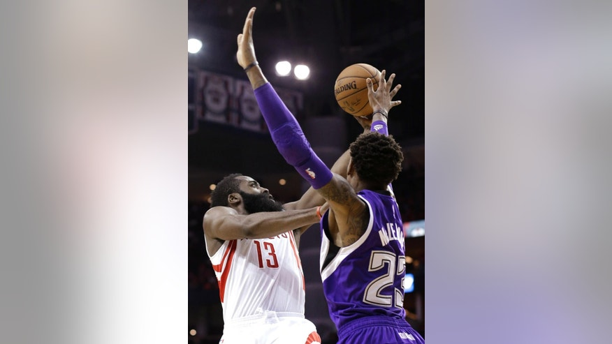 Houston Rockets' James Harden (13) pushes against Sacramento Kings' Ben McLemore in the second half of an NBA basketball game Wednesday, Nov. 26, 2014, in Houston. The Rockets won 102-89. (AP Photo/Pat Sullivan)