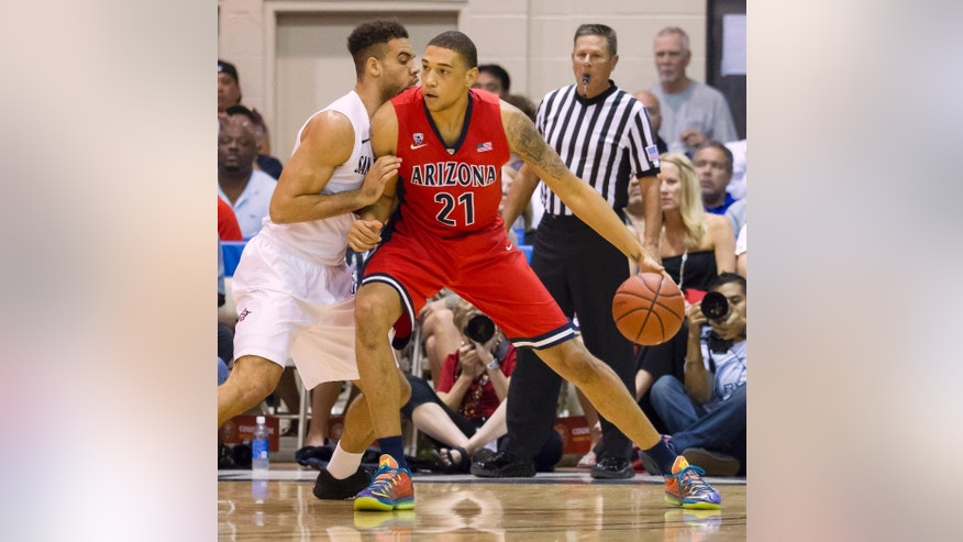 Arizona forward Brandon Ashley (21) post up against San Diego State forward J.J. O'Brien, left, in the first half of an NCAA college basketball game at the Maui Invitational on Wednesday, Nov. 26, 2014, in Lahaina, Hawaii. (AP Photo/Eugene Tanner)