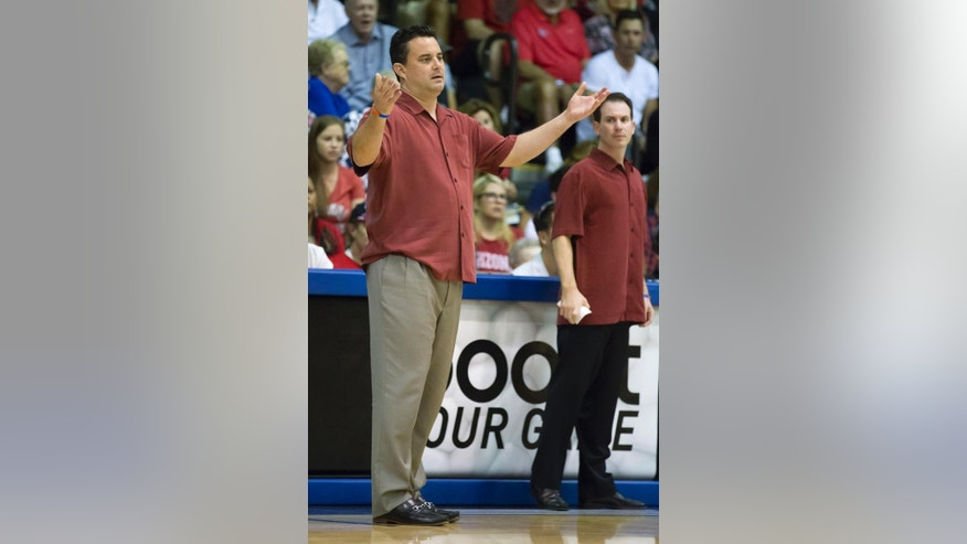 Arizona head coach Sean Miller expresses his disappointment on a foul called against one of his players to a game official in the first half of an NCAA college basketball game at the Maui Invitational on Wednesday, Nov. 26, 2014, in Lahaina, Hawaii.  (AP Photo/Eugene Tanner)